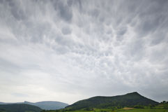 Cloudscape of mammatus clouds and the mountains. Spectacular cloudscape of mammatus clouds and the mountains Royalty Free Stock Photography