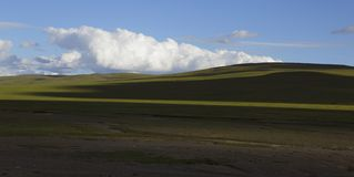 Cloudscape with a meadow. Beautiful cloudscape in the west of  china Royalty Free Stock Image