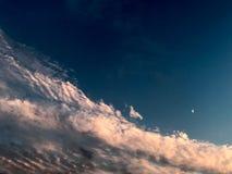 Cloudscape med månen royaltyfria bilder
