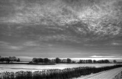 Cloudscape nad wsią Zdjęcia Royalty Free