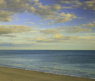 Cloudscape over beach. Scenic view of blue sky and cloudscape over sandy beach Stock Photography