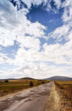 Cloudscape over country road Royalty Free Stock Image
