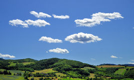 Cloudscape over countryside Stock Photos