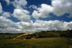 Cloudscape over countryside. Scenic view of blue sky and cloudscape over hilly countryside, Tolentino, Marche, Italy Royalty Free Stock Images