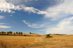 Cloudscape over field. Scenic view of blue sky and cloudscape over harvested wheat field in countryside, Burgos, Catille, Spain Stock Image