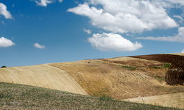Cloudscape over hills. Scenic view of blue sky and cloudscape over dry hills in countryside stock images