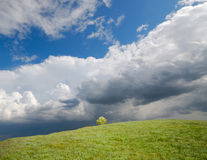 Cloudscape over hillside Stock Photos