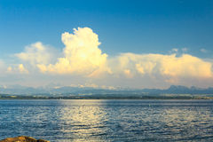 Cloudscape over lake Stock Photography