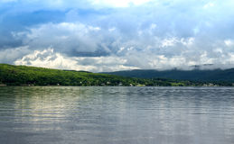 Cloudscape over lake Royalty Free Stock Photos