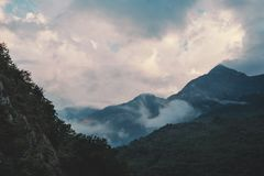 Cloudscape over mountain ridge. Stock Images