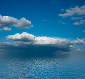 Cloudscape over sea. Scenic view of blue sky and cloudscape over calm sea Royalty Free Stock Photo