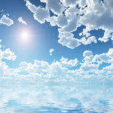 Cloudscape over sea. Sun shining in blue sky through beautiful cloudscape reflecting on sea or water royalty free illustration