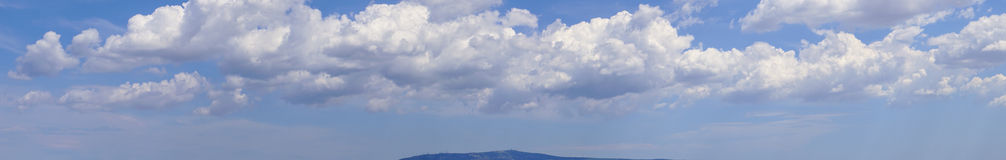 Cloudscape. Panoramic picture of white clouds and blue skies Royalty Free Stock Image