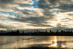 Cloudscape at Puerto Varas. Beautiful cloudscape in the morning with a beautiful lake in the foreground Royalty Free Stock Photo