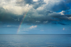 Cloudscape with rainbow Stock Images