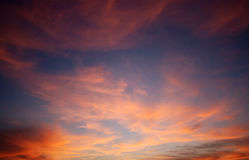 Cloudscape with red color. Background of a cloudscape in red color, Just after sunrise Royalty Free Stock Photo