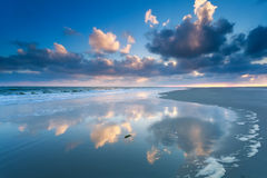 Cloudscape reflected in North sea waves Royalty Free Stock Images