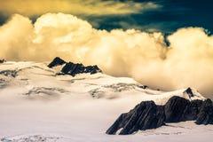Cloudscape sopra le alpi del sud in Nuova Zelanda Fotografia Stock