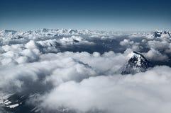 Cloudscape sopra le montagne Fotografia Stock