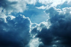 Cloudscape with stormy clouds in sunlight Royalty Free Stock Photo