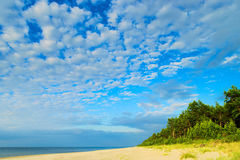 Cloudscape with stratocumulus  cloud formation over the beach at Baltic sea. Royalty Free Stock Image