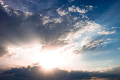 Cloudscape with sun and clouds Royalty Free Stock Image