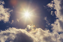 Cloudscape and sun, dramatic blue sky Stock Photography