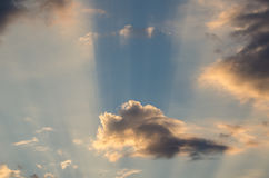 Cloudscape. With sun rays and cloud shadows Stock Images