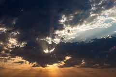 Cloudscape with the sun rays radiating from behind the cloud Stock Photography