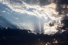 Cloudscape with the sun rays radiating from behind the cloud Royalty Free Stock Images