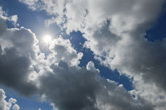 Cloudscape with the sun rays radiating from behind Stock Photo