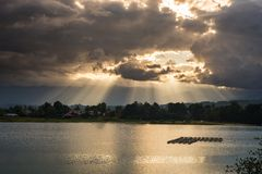 Cloudscape and sunbeams on lake Royalty Free Stock Photography