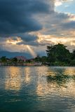 Cloudscape and sunbeams on lake Stock Image