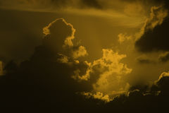 Cloudscape at sunset. Beautiful sunrays are coming through the clouds Stock Photos