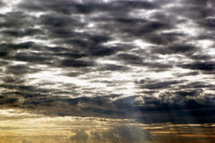 Cloudscape at sunset. Dramatic cloudscape in the sky at sunset with sunshines Stock Photo