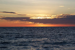 Cloudscape and sunset over the sea Stock Images