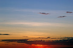 Cloudscape and sunset over the sea Royalty Free Stock Photo
