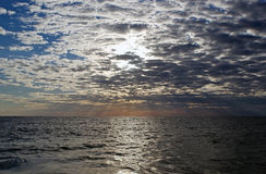 Cloudscape and sunset over the sea Royalty Free Stock Image