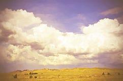 Cloudscape surrealista del campo Foto de archivo libre de regalías