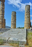 Cloudscape with The Temple of Apollo in Ancient Greek archaeological site of Delphi, Greece Royalty Free Stock Photography