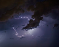 Cloudscape with thunder bolt. Cloudscape with lightning bolt hitting among the clouds Stock Image