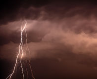 Cloudscape with thunder bolt. Cloudscape with lightning bolt hitting among the clouds Stock Photo