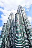 Cloudscape view of the Petronas Twin Towers at KLCC City Center. The most popular tourist destination in Malaysian capital Stock Images
