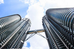 Cloudscape view of the Petronas Twin Towers at KLCC City Center. The most popular tourist destination in Malaysian capital Royalty Free Stock Image