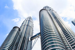 Cloudscape view of the Petronas Twin Towers at KLCC City Center. The most popular tourist destination in Malaysian capital Royalty Free Stock Photography