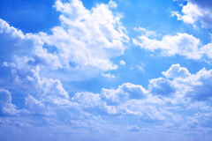 Cloudscape. White clouds in the bright sky Stock Photography