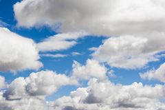 Cloudscape. White cotton clouds against a blue sky Royalty Free Stock Image