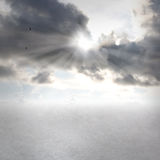 Cloudscapes with sunbeams. Gray clouds and sunbeams with open land royalty free stock photography