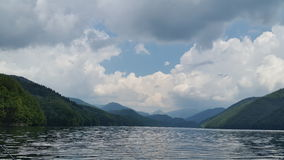 Cloudy atmosphere over the mountain lake Royalty Free Stock Photography