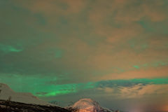 Cloudy Aurora Borealis, Northern Lights Royalty Free Stock Photography